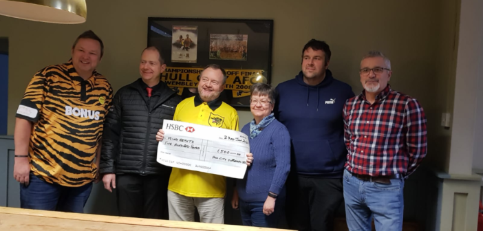 Charity Shirt Cheque Presentations